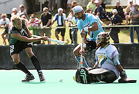 Shay Neal's shot is blocked by India goalie Baljit Singh as captain Sandeep Singh looks on during the international hockey match between the New Zealand Black Sticks and India at National Hockey Stadium, Wellington, New Zealand on Saturday, 20 February 2009. Photo: Dave Lintott / lintottphoto.co.nz