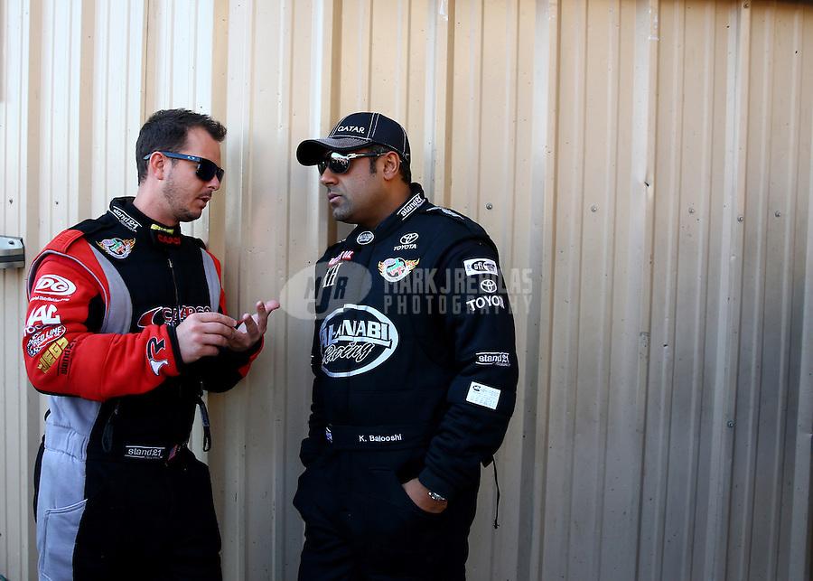 Jul. 21, 2013; Morrison, CO, USA: NHRA top fuel dragster driver Steve Torrence (left) talks with Khalid Albalooshi during the Mile High Nationals at Bandimere Speedway. Mandatory Credit: Mark J. Rebilas-