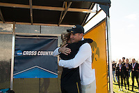 Missouri junior Karissa Schweizer gets a hug from coach Marc Burns after receving her first-place medalat the NCAA Division I Cross Country Midwest Regional in Iowa City, Ia. Friday November 11, 2016. Schweizer led the Tigers to their first victory at the meet since 2003, and their first NCAA Championship berth since 2004.