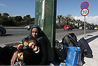 Pictured: A refugee mother and her child outside the Helliniko refugee camp Friday 26 February 2016<br />