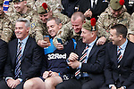 Mark Warburton with his magic hat as he meets the members of the armed forces at Ibrox today
