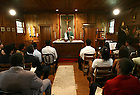 Fr. Malloy says Mass in the Log Chapel for a summer program session, summer 2006..Photo by Matt Cashore..