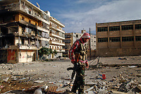 Free Syria Army soldiers attached to the Liwa Tawhid brigade get ready to move to a different fighting position in the Al Arqoob district in the heart of Aleppo city on Wednesday, October 10, 2012. ..© Javier Manzano