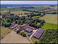 BNPS.co.uk (01202)558833<br /> Pic:   Savills/BNPS<br /> <br /> Aerial shot of the farm buildings.<br /> <br /> A 800 year old castle that stands over Prince Charles' Highgrove estate and was left a ruin by the Civil War has gone on the market for £10m.<br /> <br /> Beverston Castle, on the outskirts of Tetbury, Gloucs, is only partly habitable today but has a charming seven bedroom manor house built on to it.<br /> <br /> The historic property, that comes with a huge 693 acres of land, had been owned for 70 years by the late showjumper Major Laurence Rook and his wife Jane.<br /> <br /> The couple were famed for the hospitality they laid on to visitors of the week-long Badminton Horse Trials which is nearby.
