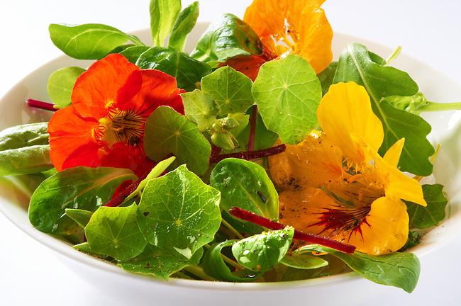 Fresh nasturtium flowers & leaves in a salad