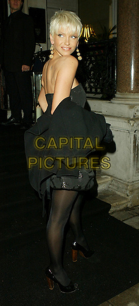 SARAH HARDING .Leaving Links of London - watch launch event, Il Bottaccio, Grosvenor Place, London, England. .September 25th, 2007.full length black strapless dress clutch purse wooden heel shoes looking over shoulder .CAP/FEE.©FEE/Capital Pictures.