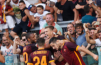 Calcio, Serie A: Roma vs Juventus. Roma, stadio Olimpico, 30 agosto 2015.<br /> Roma&rsquo;s Edin Dzeko, second from right, celebrates with teammates after scoring during the Italian Serie A football match between Roma and Juventus at Rome's Olympic stadium, 30 August 2015.<br /> UPDATE IMAGES PRESS/Riccardo De Luca