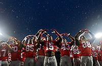 Ohio State players sing Carmen Ohio with the band following their 56-17 win over Rutgers in the NCAA football game at Ohio Stadium in Columbus on Oct. 18, 2014. (Adam Cairns / The Columbus Dispatch)