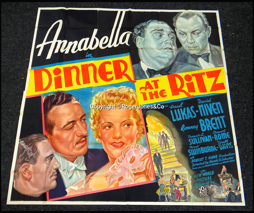 BNPS.co.uk (01202 558833)<br /> Pic: RogerJones&Co/BNPS<br /> <br /> Dinner at the Ritz, 1937.<br /> <br /> A rare collection of 1930s and 40s cinema posters discovered by two builders after they were used as carpet underlay have sold for a whopping £75,000.<br /> <br /> More than half the total was made on a single poster, John Wayne's breakthrough film Stagecoach (1939), which sold for £31,000.<br /> <br /> The classic Hollywood movie posters, which were in near pristine condition, are from the halcyon days of cinema and included well known names such as Alfred Hitchcock, Sir Laurence Olivie and Boris Karloff.<br /> <br /> Before the sale auctioneers Rogers Jones & Co said it was difficult to predict what the posters would sell for as no comparisons had ever come to market but the collection of about 120 posters was expected to fetch several thousands.<br /> <br /> Two builders made the discovery in 1985 when they were renovating the home of a local cinema owner who had died in Penarth, south Wales.