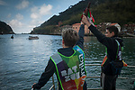 "Baton crosses Pasay bay on a boat on the 20th Korrika.  Pasaia (Basque Country). April 4, 2017. The ""Korrika"" is a relay course, with a wooden baton that passes from hand to hand without interruption, organised every two years in a bid to promote the basque language. The Korrika runs over 11 days and 10 nights, crossing many Basque villages and cities. This year was the 20th edition and run more than 2500 Kilometres. Some people consider it an honour to carry the baton with the symbol of the Basques, ""buying"" kilometres to support Basque language teaching. (Gari Garaialde / Bostok Photo)"
