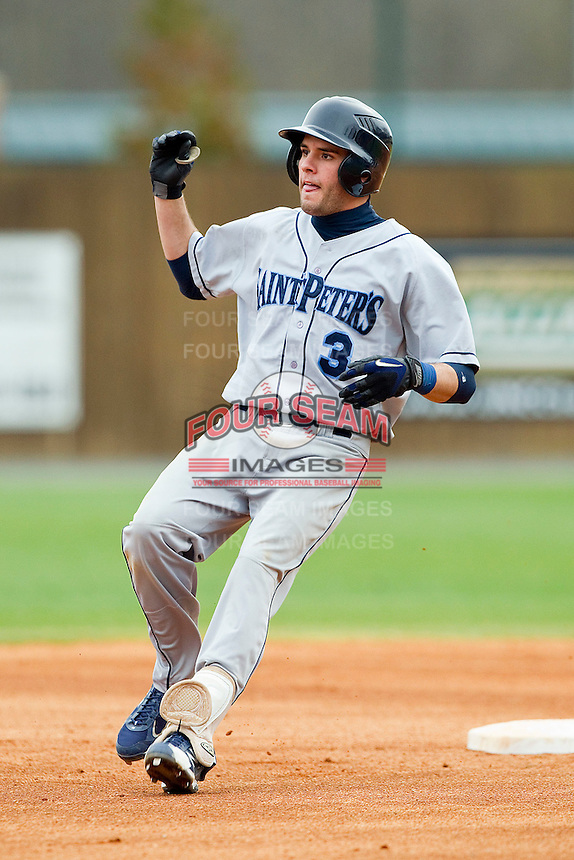 Alberto Rodriguez #3 of the Saint Peter's Peacocks rounds second base after hitting a double against the Charlotte 49ers at Robert and Mariam Hayes Stadium on February 18, 2012 in Charlotte, North Carolina.  Brian Westerholt / Four Seam Images