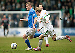 St Johnstone v Celtic.....14.02.15<br /> Brian Easton is closed down by Gary Mackay-Steven<br /> Picture by Graeme Hart.<br /> Copyright Perthshire Picture Agency<br /> Tel: 01738 623350  Mobile: 07990 594431