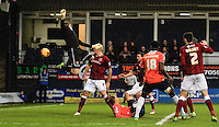 Paul Benson of Luton Town ( on the floor ) scores the opening goal of the game during the Sky Bet League 2 match between Luton Town and Northampton Town at Kenilworth Road, Luton, England on 12 December 2015. Photo by Liam Smith/Prime Media Images.