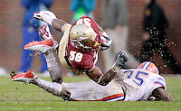 TALLAHASSEE, FL. 11/29/08-FSU-UF 1st CH15-Florida State's Jermaine Thomas is decleated by Florida's Ahmad Black  during first half action Saturday at Doak Campbell Stadium in Tallahassee. ..COLIN HACKLEY PHOTO FOR NOLEINSIDER.COM