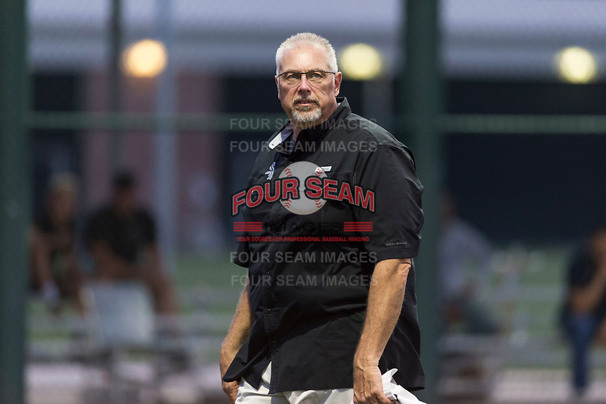 AZL White Sox athletic trainer Scott Johnson walks off the field after checking on catcher Kleyder Sanchez (not pictured) during an Arizona League game against the AZL Cubs 2 at Sloan Park on July 13, 2018 in Mesa, Arizona. The AZL Cubs 2 defeated the AZL White Sox by a score of 6-4. (Zachary Lucy/Four Seam Images)