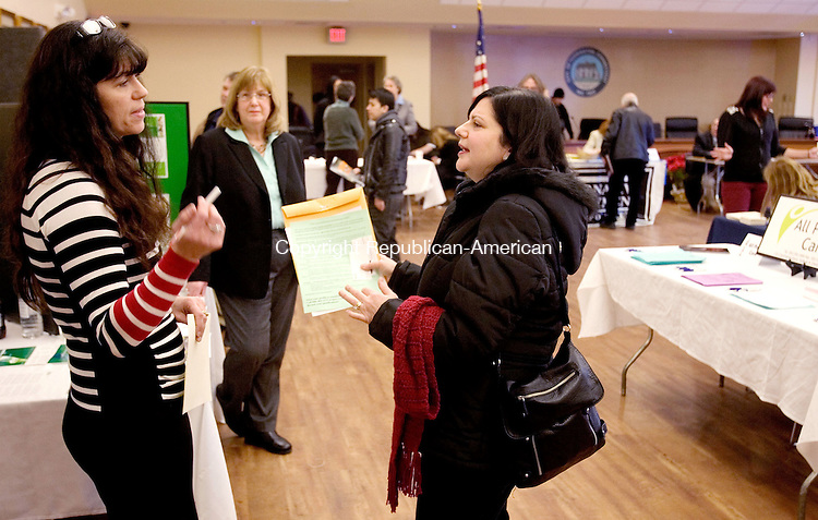 TORRINGTON CT. 20 February 2014-022014SV03-From left, Mary Mantoni of Kelly Services talks with Robin Gemetro of Winsted who was looking for a job during the 10th annual Northwest Connecticut Chamber job fair at City Hall auditorium in Torrington Thursday.<br /> Steven Valenti Republican-American