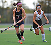 Manhasset No. 7 Regan Moroney, left, gets pressured by Garden City No. 7 Celia Concannon during the Nassau County varsity field hockey Class B final at Adelphi University on Sunday, November 1, 2015. Garden City won by a score of 9-0.<br /> <br /> James Escher