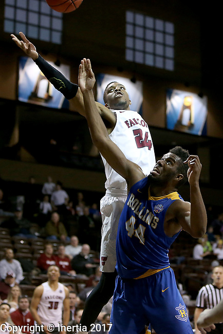 SIOUX FALLS, SD: MARCH 22: Trevor Andrews-Evans #24 from Fairmont State soars for a rebound over Jeff Merton #44 from Rollins during the Men's Division II Basketball Championship Tournament on March 22, 2017 at the Sanford Pentagon in Sioux Falls, SD. (Photo by Dave Eggen/Inertia)