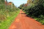 Prince Edward Island, Canada.   Red earth road.
