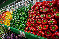 Red, green, yellow and orange peppers and other vegetables are seen on sale in a grocery store in New York on Friday, February 22, 2013. (© Richard B. Levine)