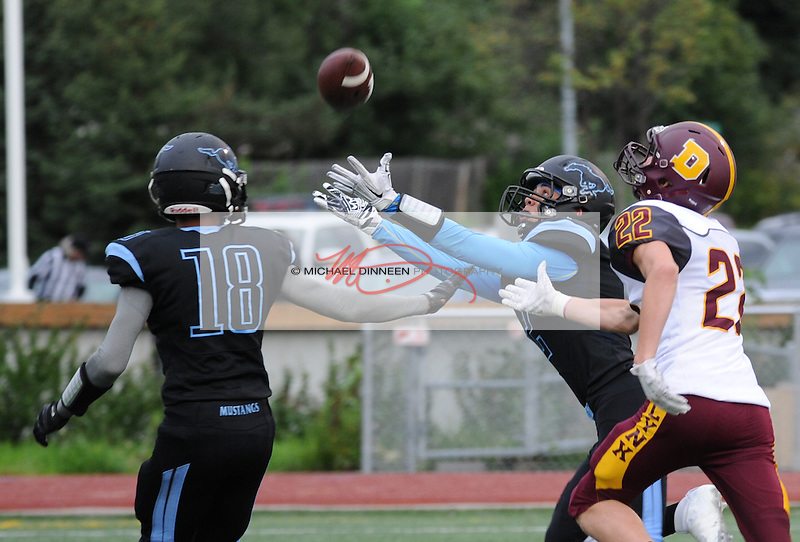 Chugiak's Anthony Jones reaches for a pass as teammate Ramal Maad and a Dimond defender look on . Photo by Michael Dinneen for the Star.