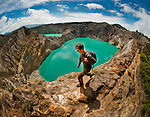 A trekker (Jeremy Holden) hikes around the colorful Kelimutu lakes, Flores, Indonesia