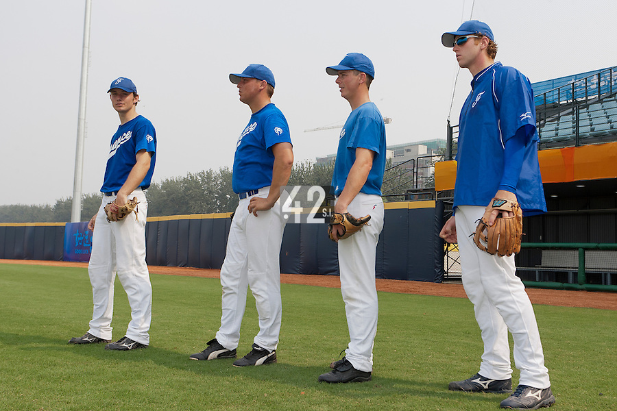 17 August 2007: Edouard Masse, Giovanni Ouin, Anthony Piquet, and Nicolas Dubaut are seen during the Good Luck Beijing International baseball tournament (olympic test event) at the Wukesong Baseball Field in Beijing, China.