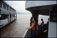 Fengdu, China, August 2003.A ferry crossing on the Yangtze Kiang river between the old and the new city of Fengdu.