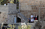 Ultra-Orthodox Jewish visit the Jewish shrine of Atnaeil Ben Kinaz during the Jewish Sukkot holiday or the feast of the Tabernacles in a Palestinian neighbourhood of the divided West Bank city of Hebron on Oct. 19, 2016. Photo by Wisam Hashlamoun