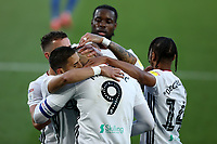 10th July 2020; Craven Cottage, London, England; English Championship Football, Fulham versus Cardiff City; Aleksandar Mitrovic of Fulham celebrates with team mates after he scores from the penalty spot for 1-0 in the 35th minute
