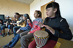 A girl plays a drum as a guitarist leads students in singing during a class in the Instituto de Buena Voluntad (the Good Will Institute) in Montevideo, Uruguay. Sponsored by the Methodist Church of Uruguay, the institute works with youth and adults with disabilities. It receives financial support from United Methodist Women.