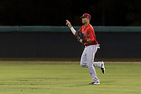 AZL Angels center fielder Jordyn Adams (21) acknowledges a teammate as he jogs off the field between innings of an Arizona League game against the AZL Dodgers at Camelback Ranch on July 8, 2018 in Glendale, Arizona. The AZL Dodgers defeated the AZL Angels by a score of 5-3. (Zachary Lucy/Four Seam Images)