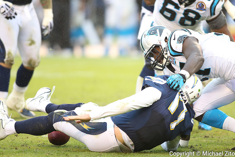 12/16/12 San Diego, CA:  Carolina Panthers linebacker Mario Addison #97 and San Diego Chargers quarterback Philip Rivers #17 during an NFL game played between the Carolina Panthers and the San Diego Chargers held at Qualcomm Filed. The Panthers defeated the Chargers 31-7