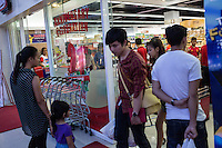 March 30, 2014 - Phnom Penh, Cambodia. People shop and visit TK Avenue, a popular mall area. © Nicolas Axelrod / Ruom