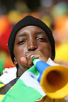 11 JUN 2010: South African fan with a vuvuzela in the stands of the Soccer City Stadium, pregame. The South Africa National Team played the Mexico National Team at Soccer City Stadium in Johannesburg, South Africa in the opening match of the 2010 FIFA World Cup.