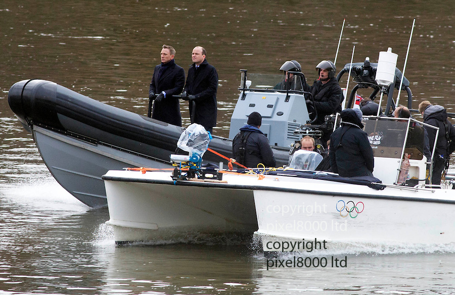 Pic shows: Daniel Craig and Rory Kinnear<br /> <br /> filming new James Bond film Spectre outside the headquarters of MI5 today in Central London,<br /> <br /> <br /> <br /> <br /> Pic by Gavin Rodgers/Pixel 8000 Ltd
