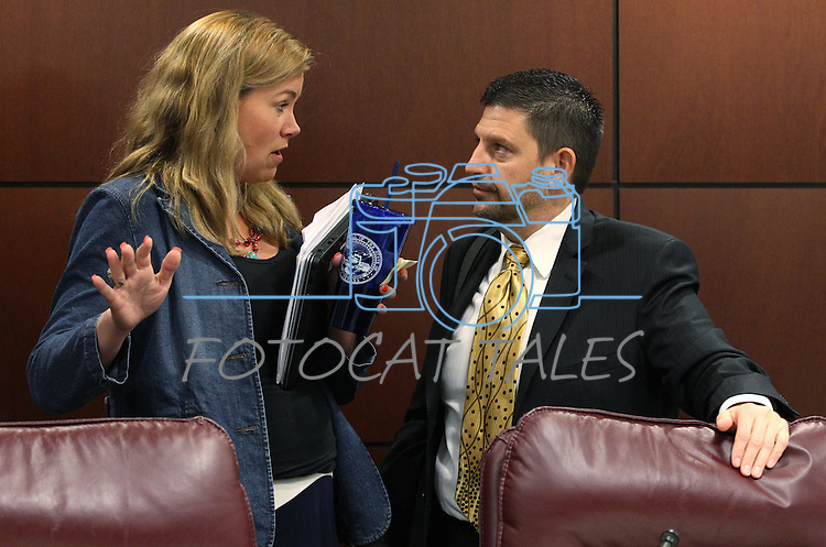 Nevada Sens. Patricia Farley, R-Las Vegas, and Mark Manendo, D-Las Vegas, talk after a hearing at the Legislative Building in Carson City, Nev., on Friday, March 20, 2015. <br /> Photo by Cathleen Allison