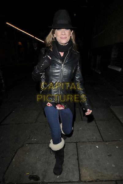 """HANNAH WATERMAN.Leaving after the evening performance of """"Calendar Girls"""", London, England..January 6th, 2010.full length black leather jacket scarf hat jeans denim fur furry boots .CAP/CAN.©Can Nguyen/Capital Pictures."""