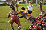 Anzac Luteru manages to disrupt Siale Piutau's clearing pass from a ruck.  Counties Manukau Premier Club Rugby game between Patumahoe & Karaka played at Patumahoe on Saturday June 13th 2009. Patumahoe lead 8 - 0 at halftime and went on to win 20 - 0.