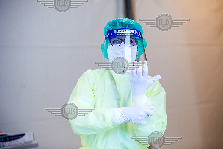 Nurses in personal protective equipment (PPE) preapare to test people for Covis-19, corona virus, outside Drammen hospital. <br /> <br /> <br /> <br /> <br /> ©Fredrik Naumann/Felix Features