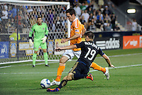 Jack McInerney (19) of the Philadelphia Union is defended by Hunter Freeman (21) of the Houston Dynamo. The Philadelphia Union and the Houston Dynamo played to a 1-1 tie during a Major League Soccer (MLS) match at PPL Park in Chester, PA, on August 6, 2011.