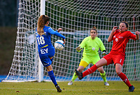 20191221 - WOLUWE: Gent's Nelle Van Parijs (18) has an attempt on goal, while Woluwe's Anouck Coechez  defends, during the Belgian Women's National Division 1 match between FC Femina WS Woluwe A and KAA Gent B on 21st December 2019 at State Fallon, Woluwe, Belgium. PHOTO: SPORTPIX.BE | SEVIL OKTEM