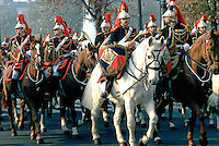 Armistice Day Parade on the Champs Elysee. A military parade on horseback with very lavish, regal uniforms. Paris, France parade.