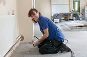 Premises staff refurbishing a room,  State Secondary Roman Catholic school.