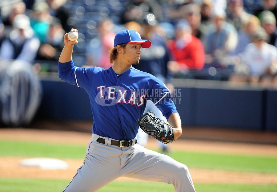 Mar. 7, 2012; Peoria, AZ, USA; Texas Rangers pitcher Yu Darvish pitches in the second inning against the San Diego Padres at Peoria Stadium.  Mandatory Credit: Mark J. Rebilas-.