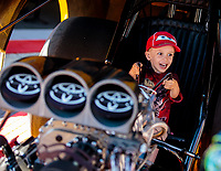 Jun 1, 2018; Joliet, IL, USA; A young NHRA fan reacts as he sits in the seat of the Toyota funny car during qualifying for the Route 66 Nationals at Route 66 Raceway. Mandatory Credit: Mark J. Rebilas-USA TODAY Sports