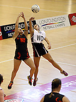 29.09.2014 Eastern Waikato's Nicole Foster and Counties Manukau's Saskia-Rae Brown in action during the Counties Manukau v Eastern Waikato duing the Lion Foundation Netball Champs at the Trusts Stadium in Auckland. Mandatory Photo Credit ©Michael Bradley.