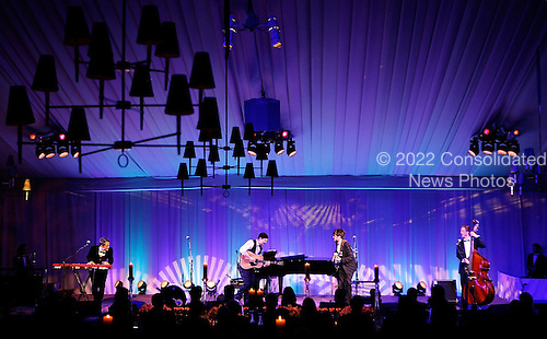 Members of the band Mumford & Sons, (L-R) Ben Lovett, Marcus Mumford, Winston Marshall, and Ted Dwane perform during a state dinner, hosted by U.S. President Barack Obama for British Prime Minister David Cameron, at the South Lawn of the White House March 14, 2012 in Washington, DC. Prime Minister Cameron was on a three-day visit in the U.S. and he had talks with President Obama earlier the day.  .Credit: Brendan Hoffman / Pool via CNP
