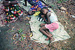 KINSHASA, DEMOCRATIC REPUBLIC OF CONGO - APRIL 30: Esther Yandakwa, age 9, sleeps outside on the ground with her friends on April 30, 2006 in Matonge district in central Kinshasa Congo, DRC. Esther is homeless and works as a prostitute together with four fourteen-year-old friends. They live outside next to a polluted river. She's been three years on the street and has run away from here family. She has from time to time been living in a homeless shelter for children, but doesn't like the rules there. She usually smokes cigarettes, marijuana, drinks whiskey and sometimes takes Valium. She charges the clients as little as US$ 1. About 15,000 children are estimated to live on the streets of Kinshasa. Congo, DRC is in ruins after forty years of mismanagement by the corrupt dictator and former president Mobuto Sese Seko. He fled the country in 1997 and a civil war started. The country is planning to hold general elections by July 2006, the first democratic elections in forty years.(Photo by Per-Anders Pettersson)