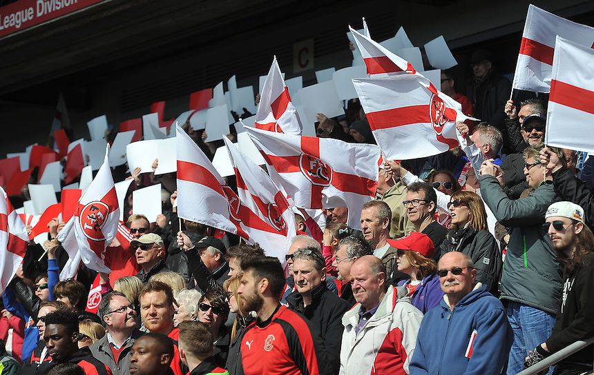 Fans wave flags for St Georges day<br /> <br /> Photographer Dave Howarth/CameraSport<br /> <br /> Football - The Football League Sky Bet League One - Fleetwood Town v Blackpool - Saturday 23rd April 2016 - Highbury Stadium - Fleetwood  <br /> <br /> &copy; CameraSport - 43 Linden Ave. Countesthorpe. Leicester. England. LE8 5PG - Tel: +44 (0) 116 277 4147 - admin@camerasport.com - www.camerasport.com